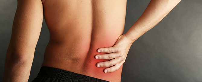 A man in need of back pain treatment in Naples, FL
